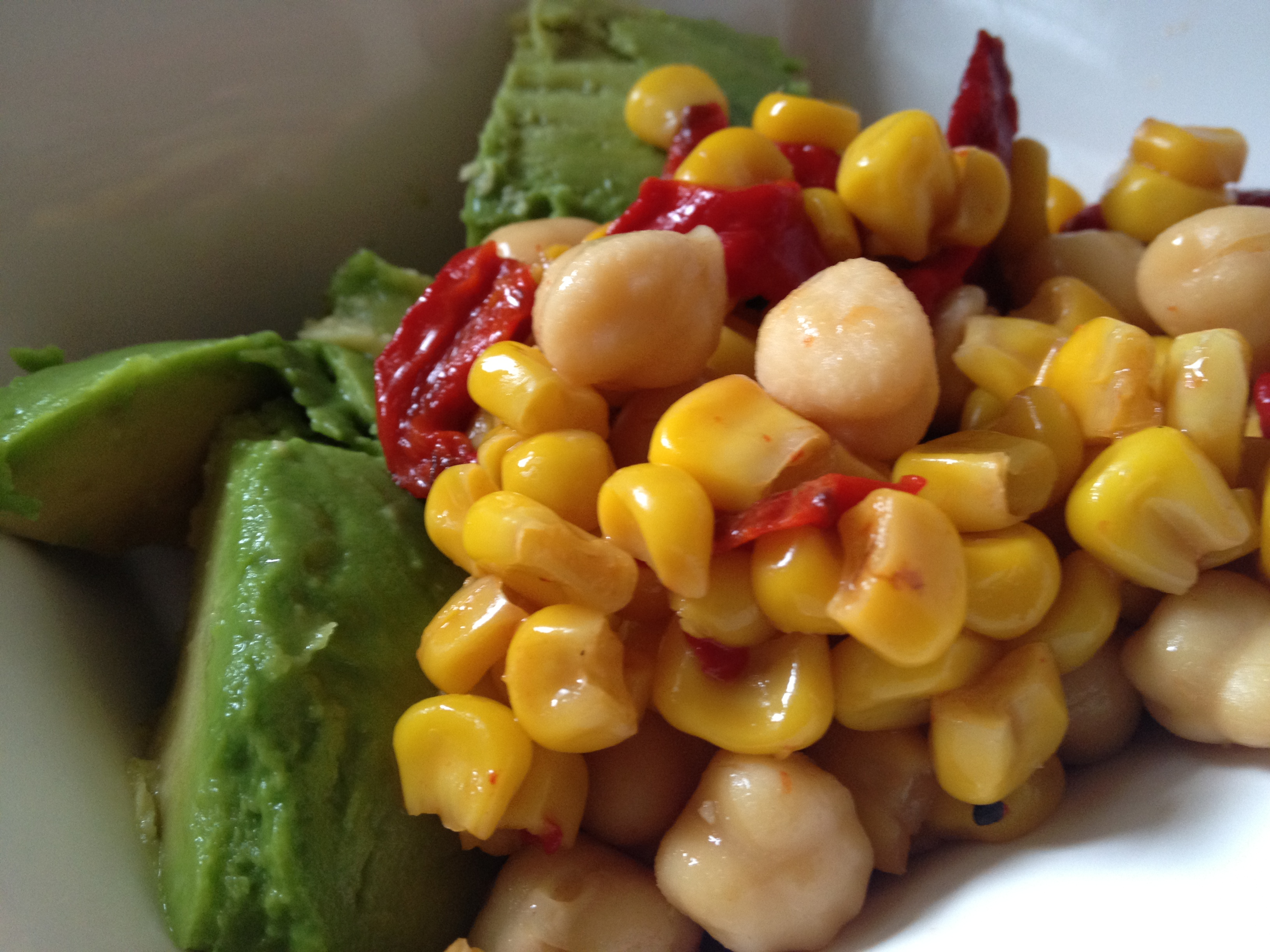Corn and red pepper with avocado and chick peas.